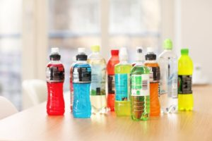 various sports drinks on wooden table