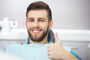 Smiling patient in the dental chair