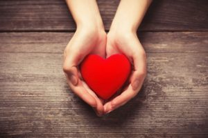 Cupped hands holding heart shape untouched by gum disease