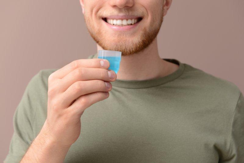 Man using mouthwash