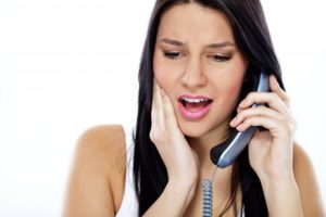 woman with dental emergency calling local dentist